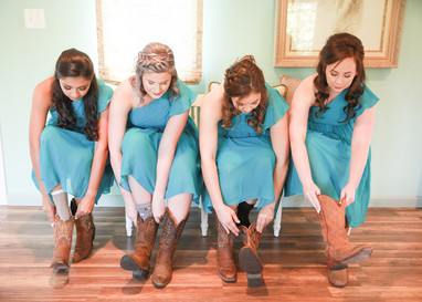 Bride getting ready at hotel with bridesmaids