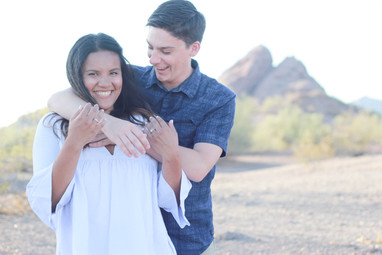 Young couple engagement photography papago park laughing