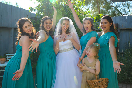 bride with bridesmaids goofing off before ceremony