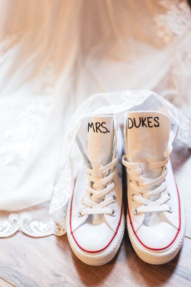 Future Mrs. Dukes with wedding dancing shoes and wedding dress