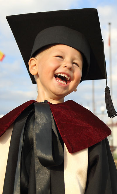 Kid in Graduation Gown