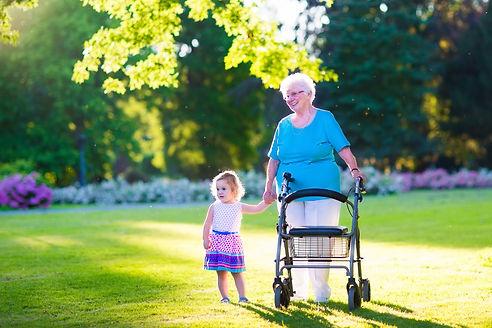 Happy senior lady with a walker or wheel