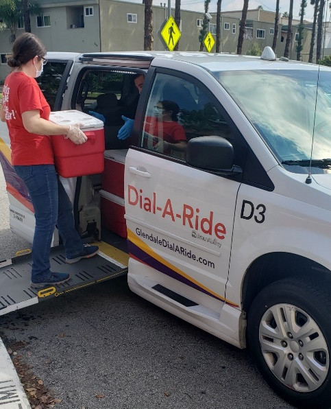 CSP Staff loading meals into a dial-a-ride van
