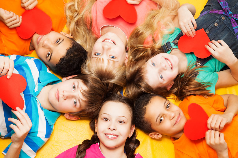 Canva - Kids Laying in Circle with Heart