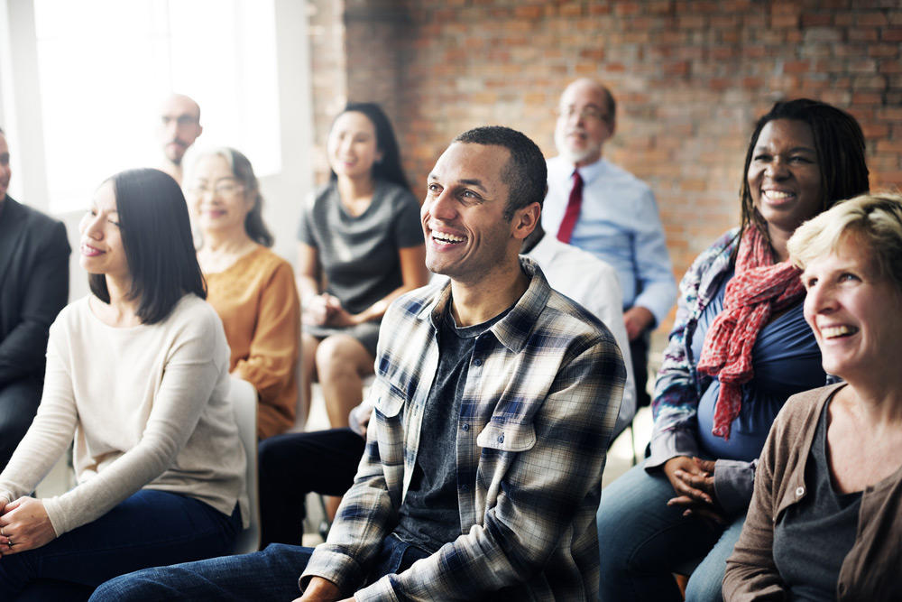 Oceanfront-Recovery-what-is-an-alanon-meeting-image-of-smiling-people-in-a-meeting-367745690