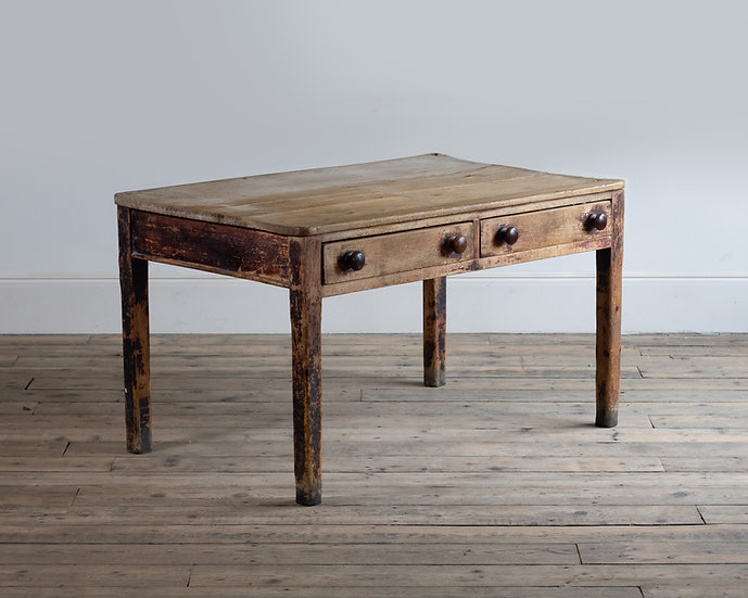 A 19th century pine kitchen table