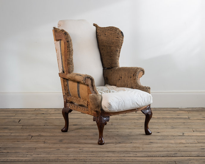 A George II style mahogany wing chair