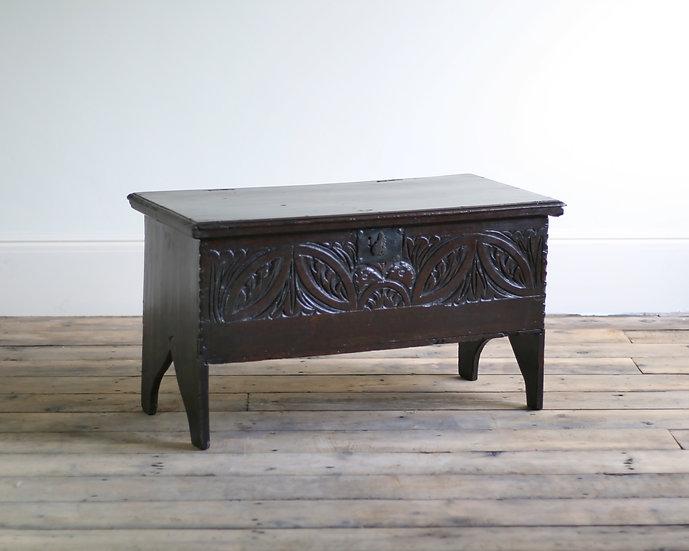 A Charles II oak plank-end coffer