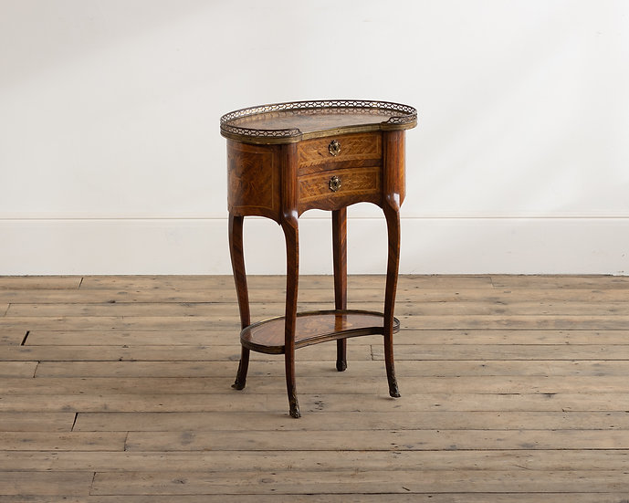 A French gilt-metal mounted kingwood marquetry table