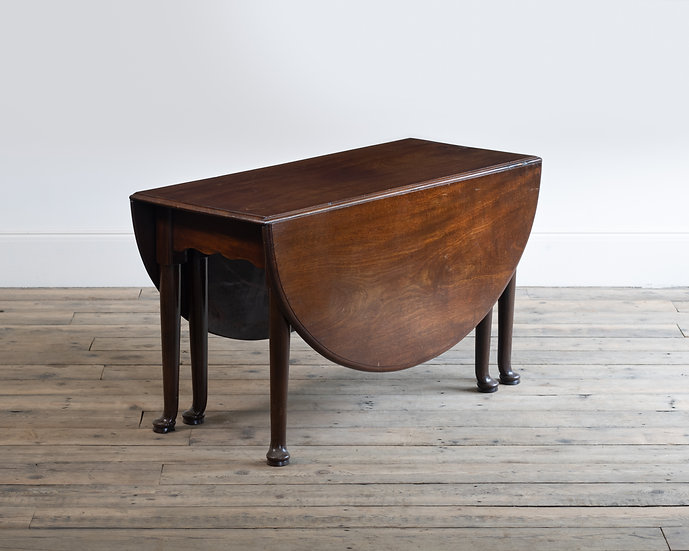 A George III mahogany drop-leaf dining table