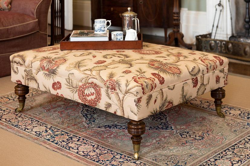 A large bespoke walnut foot stool