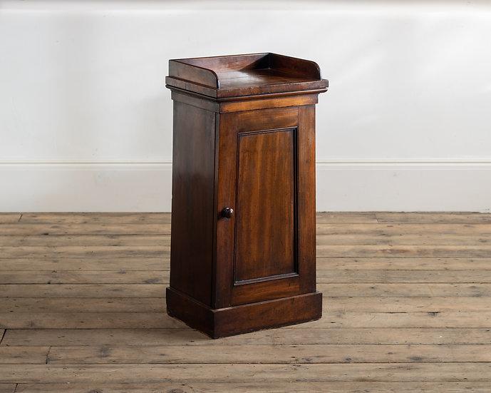 A William IV tapering mahogany pot cupboard
