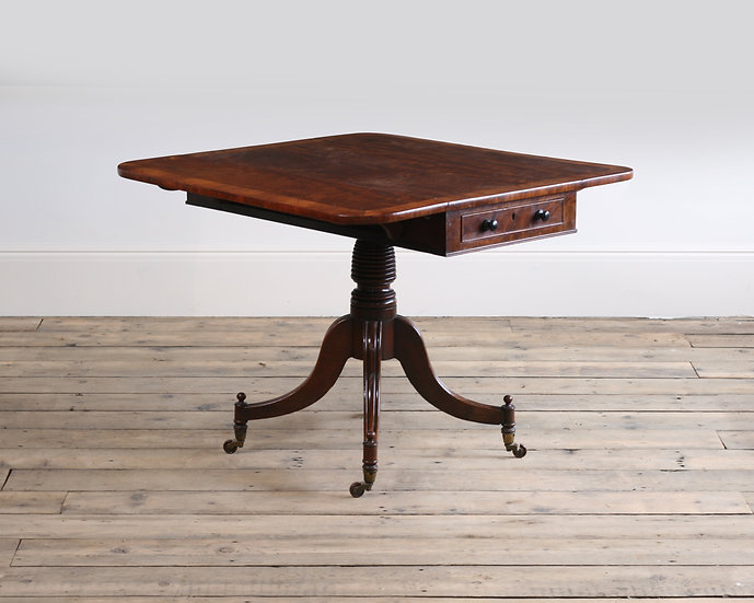A Regency mahogany and kingwood banded Pembroke table