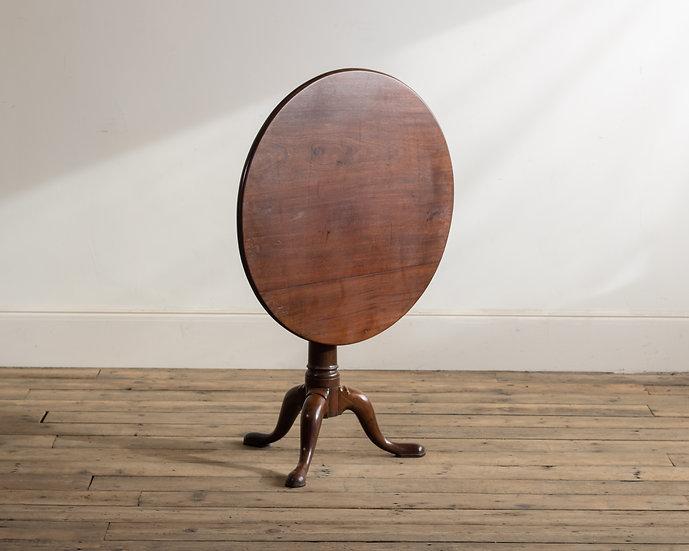 A George II mahogany 'bird-cage' tripod table