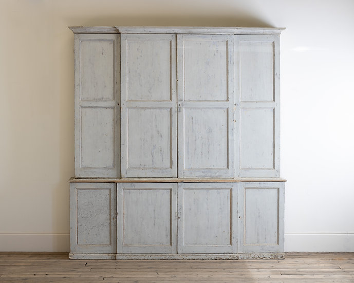 A large George III white painted housekeepers cupboard