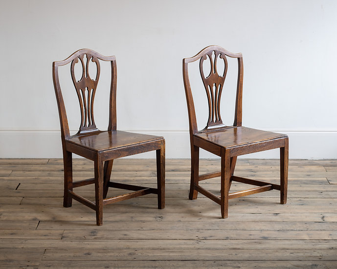 A pair of early 19th century elm side chairs
