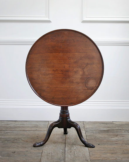 A George III mahogany 'birdcage' tripod table