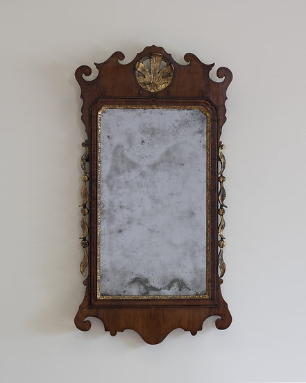 A George III mahogany and parcel-gilt wall mirror