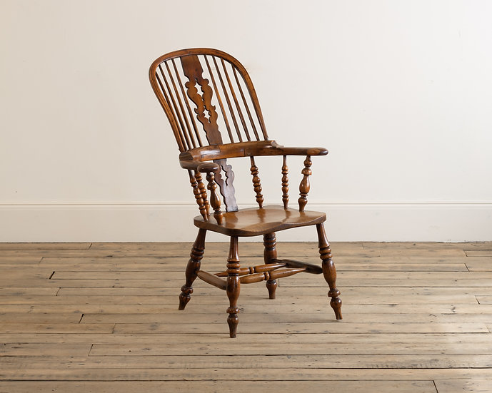 A 19th century yew wood and elm high back arm chair