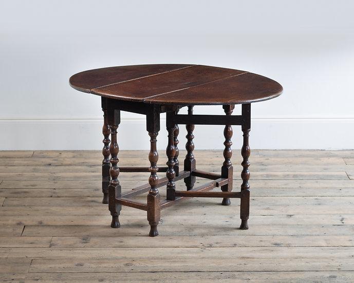 A late 17th century oak gate-leg table