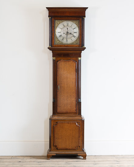 An early 19th century eight day grandfather clock