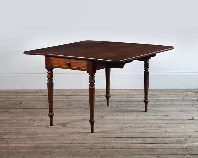 An early 19th century mahogany drop leaf table