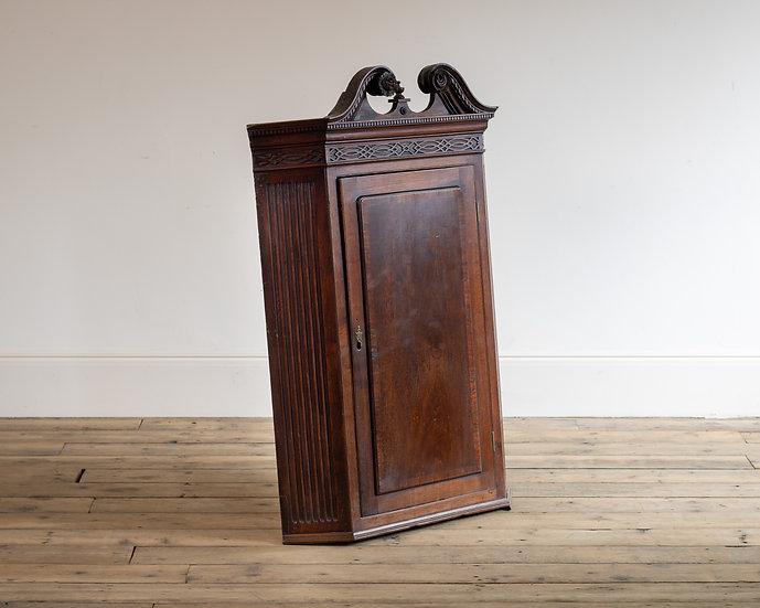 An 18th century mahogany corner cupboard
