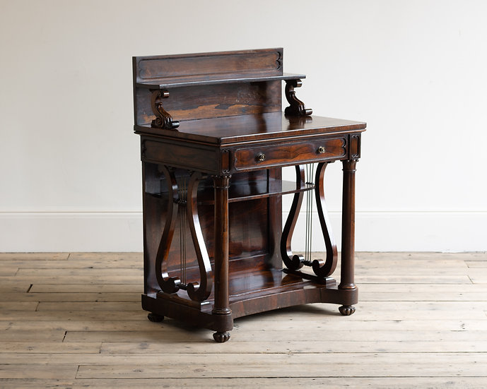 A late Regency rosewood lyre-ended chiffonier
