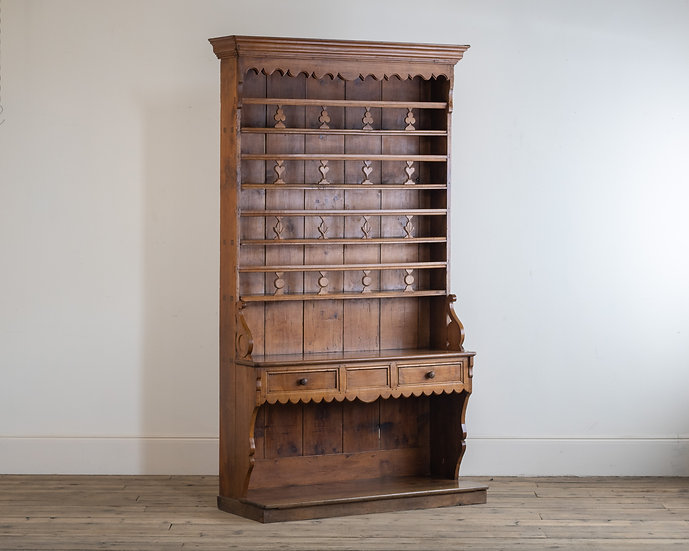 A late 19th century French chestnut dresser