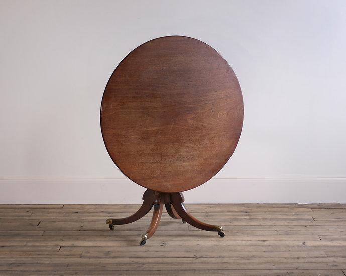 A Regency mahogany circular supper table