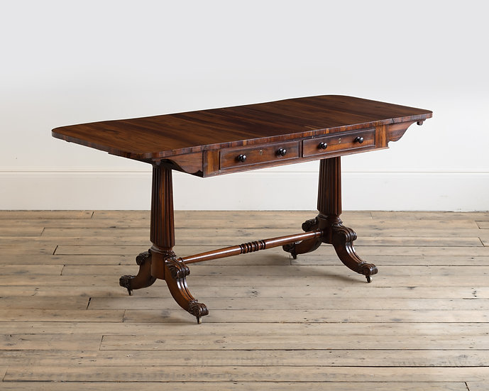 A late Regency Goncalo Alves sofa table