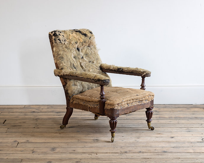 A late Regency upholstered mahogany library chair by Gillows