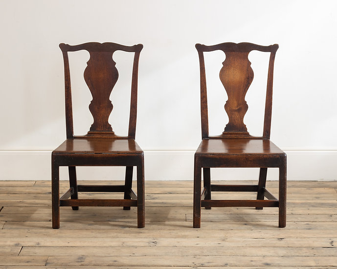 A pair of provincial mahogany side chairs