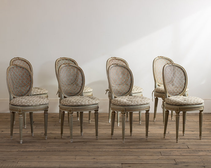 A set of eight Louis XV style painted chairs stamped Loidrault, Paris