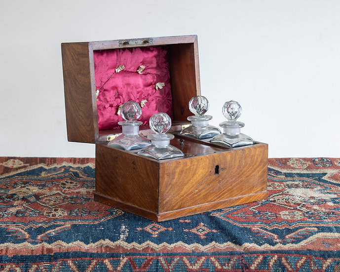 A Victorian mahogany four bottle tantalus