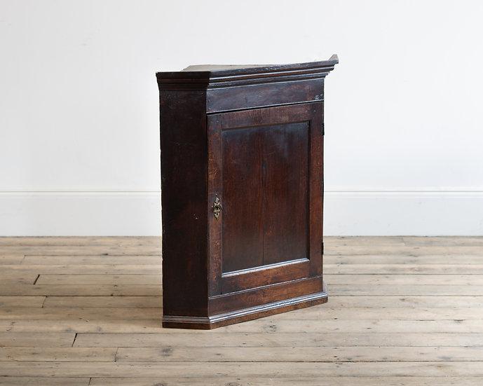 An 18th century oak corner cupboard