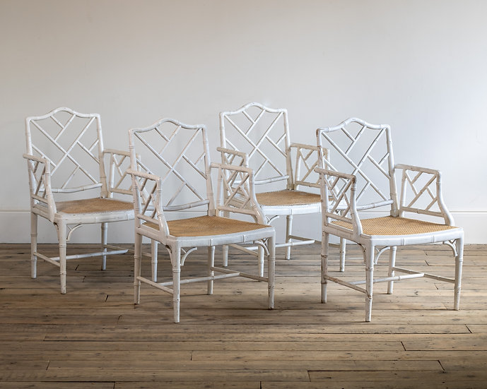 A set of four white painted faux bamboo cockpen armchairs
