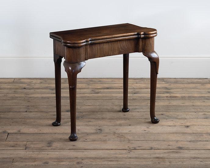 A George II mahogany pad-foot tea table