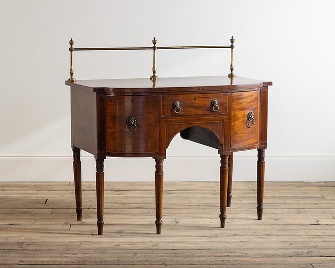 A small George III mahogany bow front sideboard