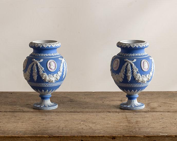A pair of tri-colour Jasperware urns by William Adams & Sons