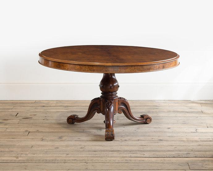 A Victorian walnut circular centre table