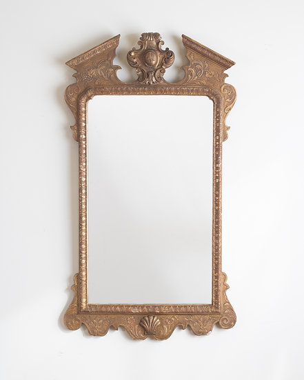 A gilt gesso wall mirror in the George II style