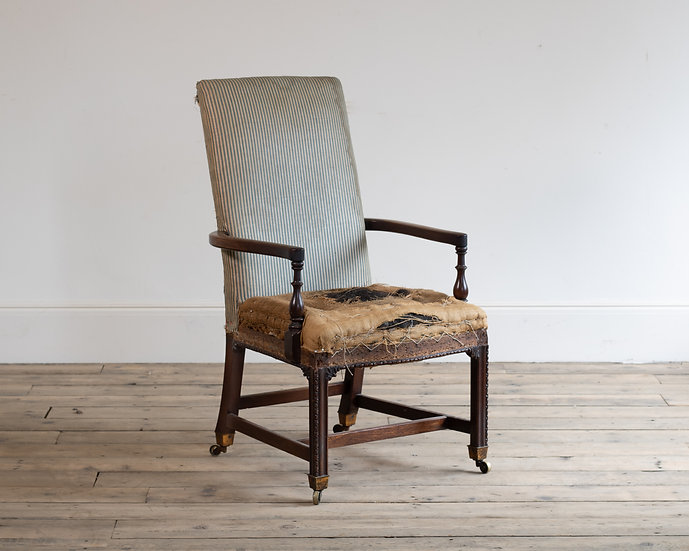 A George III mahogany library arm chair in the manner of Wright & Elwick