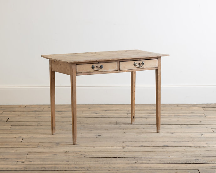 A late 18th century pine side table