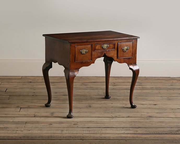 An 18th century fruitwood low boy