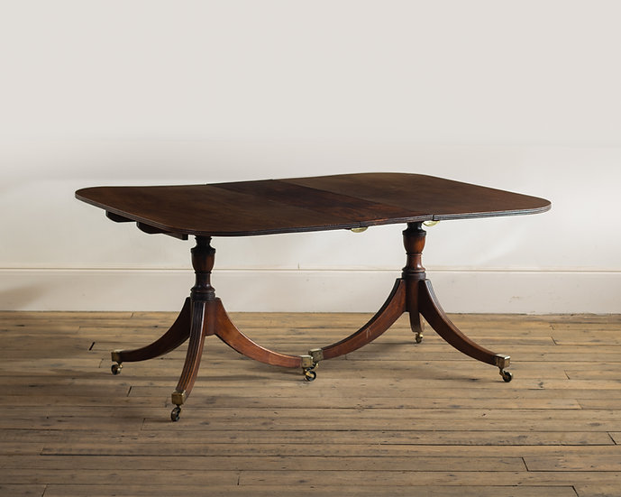 A George III mahogany twin-pedestal dining table