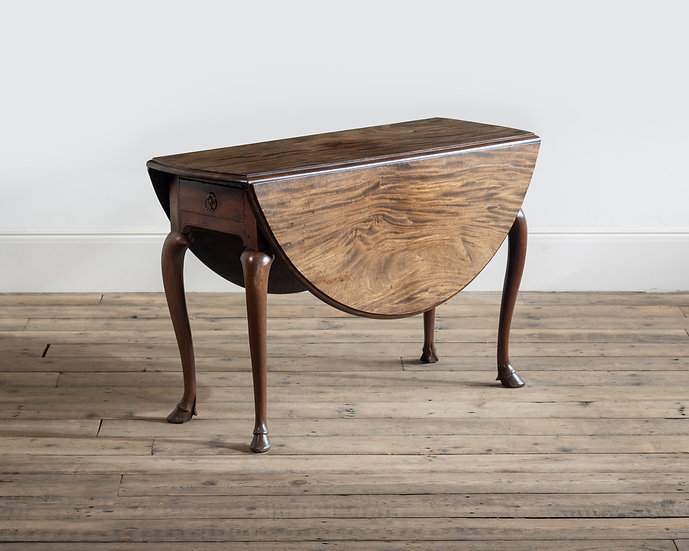 A George II mahogany drop-leaf table