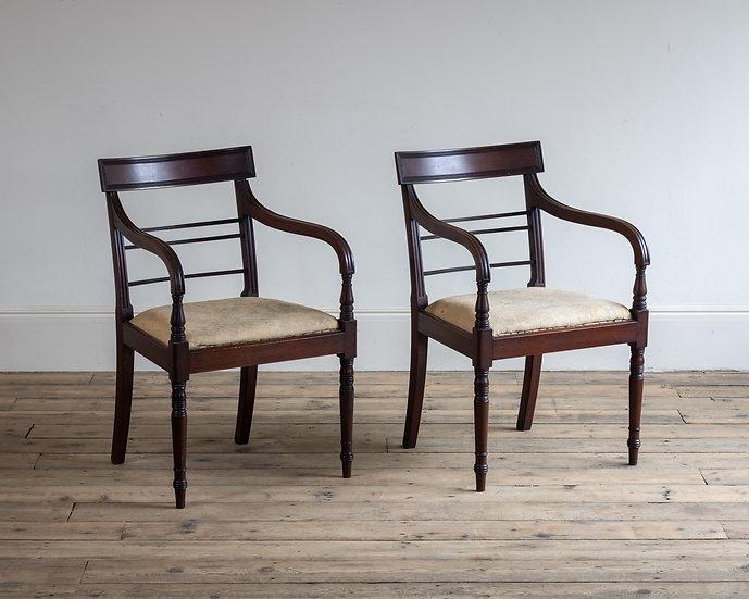 A pair of Regency mahogany arm chairs