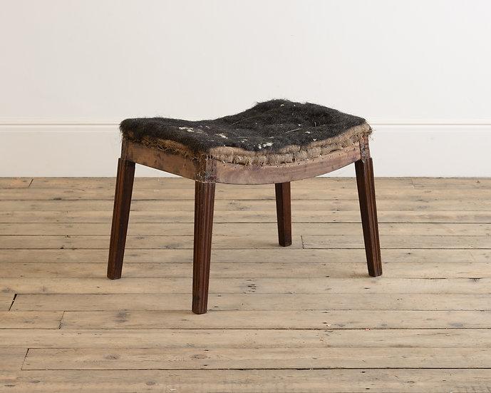A George III mahogany saddle stool