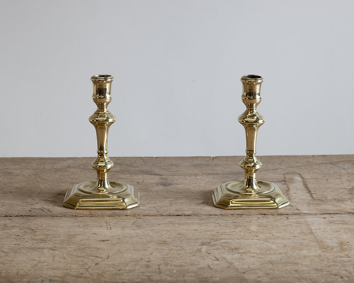 A pair of 18th century brass candle sticks